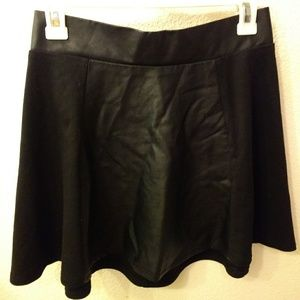 Black fabric and pleather panel skirt